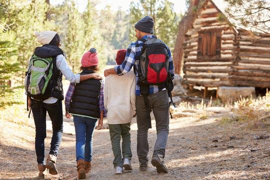 African American Family Walking Through Fall Woodland