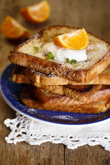 French toasts with cream and orange