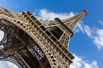 Eiffel tower, paris. View from below. Blue sky, white clouds