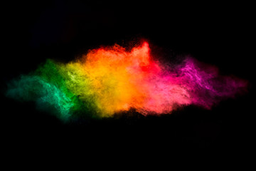 Color Explosion. Dust Particle Isolated on Black Background