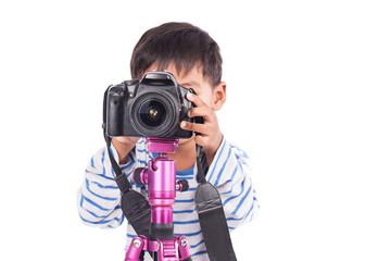 cute little boy taking camera,focus camera