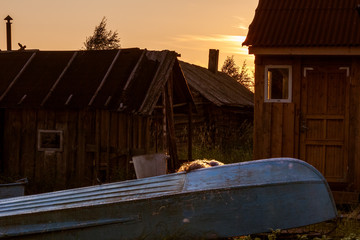 Boat and barns in sunset