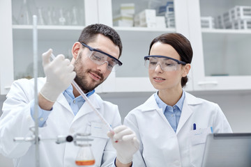 young scientists making test or research in lab