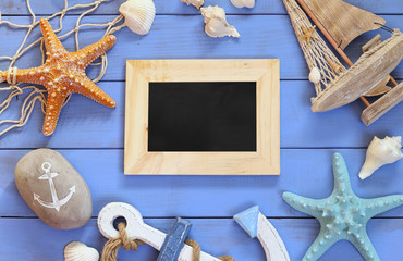 top view of nautical concept with chalkboard  next to nautical life style objects
