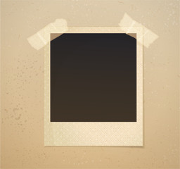 Photoframe on beige background with adhesive tape