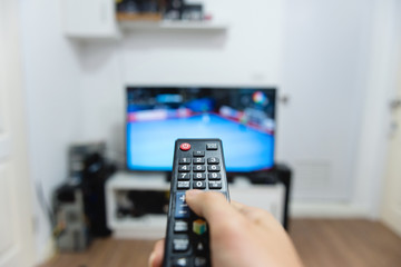Hand holding remote control TV