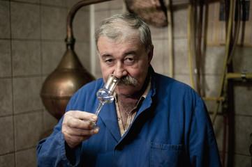 Slovenia, Istria, Kocina, portrait of distiller