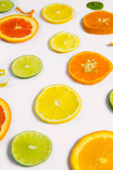 Bright colorful design of various citrus fruit slices with oranges, lemons, limes, grapefruit and tangerines.