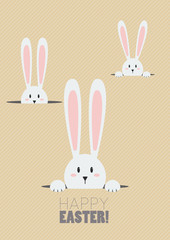 Happy Easter with white rabbits in a hole