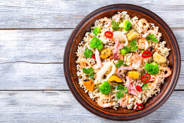 wild and brown rice with seafood and broccoli