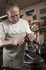 Shoemaker working in workshop