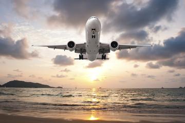 Airplane Landing in sunset
