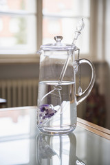 Water with gemstones in pitcher in kitchen