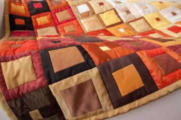Patchwork quilt. Part of patchwork quilt as background. Handmade. Blanket with klimt print.