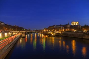 Seine river at night in Paris, France.