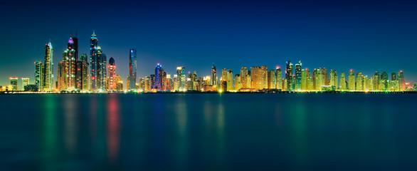 Amazing sunset panorama reflection of Dubai Marina, Dubai, United Arab Emirates