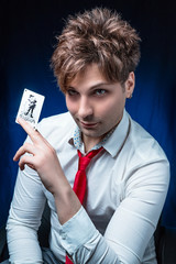 man illusionist with joker card in hand