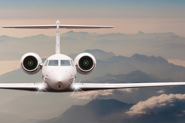 Travel by aircraft. Airplane fly over clouds and Alps mountain on down. Front view of a big passenger or cargo plane, business jet, airline. Transportation concept. Empty space for text