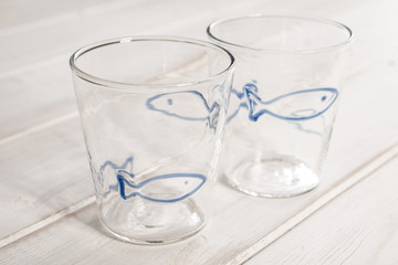 Pair of Empty Crystal Drinking Glasses with Blue Fish Design