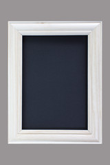 Vintage white wood picture frame on grey blackground