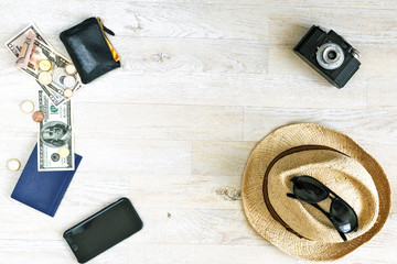 travel holidays concept with hat and vintage film camera