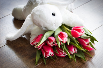 bouquet of tulips and narcissus on a wooden background
