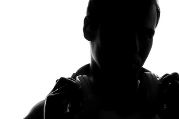 Silhouette of a young dj  with headphones