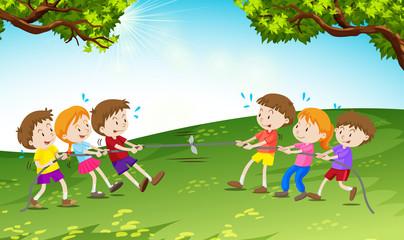 Boys and girls playing tug of war