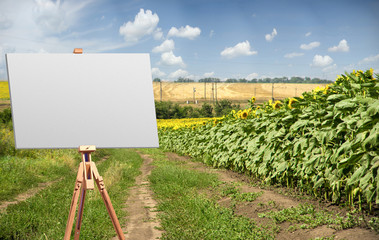 easel on the background of sunflowers