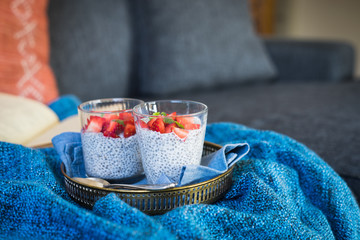 Chia seeds pudding with fresh strawberries and lemon balm. Selective focus.