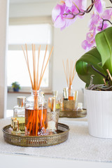 Aroma reed diffuser  in home interior. Selective focus on bottle and sticks.