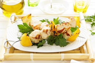 Chicken kebab on skewers with lemon.
