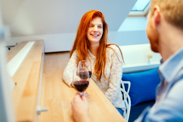 Beautiful couple drinking wine