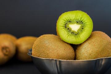 Kiwifruit on dark background