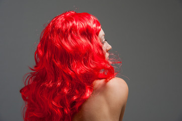 Young lady with red hair and bare skin