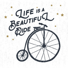 "Hand drawn textured vintage label, retro badge with bicycle vector illustration and ""Life is a beautiful ride"" inspirational lettering."