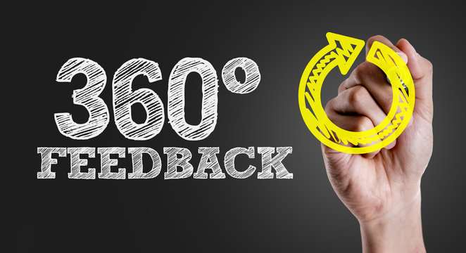 Hand writing the text: 360° Feedback