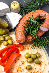 Ingredients of breakfast with cheese slices, sausage and vegetables