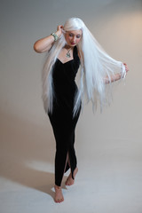 Girl with white hair and black dress