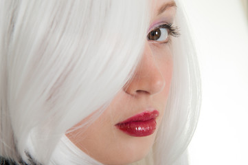 portrait of girl behind her white hair