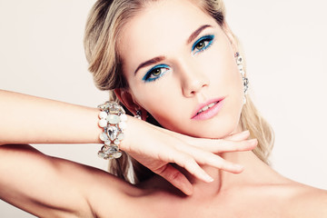 Pretty Woman Fashion Model with Makeup and Bracelet