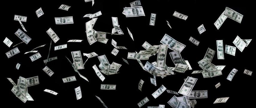 close up of us dollar money flying over black