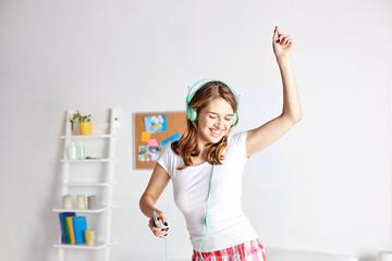 happy woman in headphones ihaving fun at home