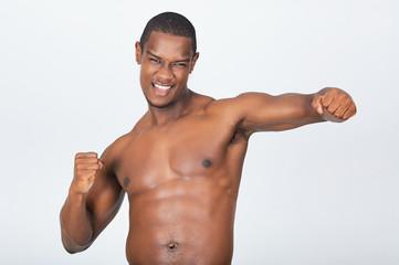 Amazing black british muscular man model at body art studio shoot