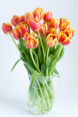 large bouquet of tulips in a glass jug
