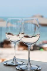 Beach restaurant serving, cocktails, food, plates. Sea view.