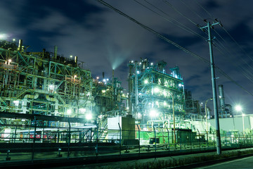 Oil refinery petrochemical industrial at night
