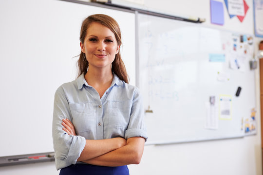 Portrait of confident young Caucasian female teacher