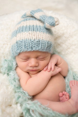 Newborn Baby Sleeping in Knit Hat