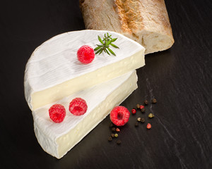 Camembert cheese with raspberry as a delicious dessert